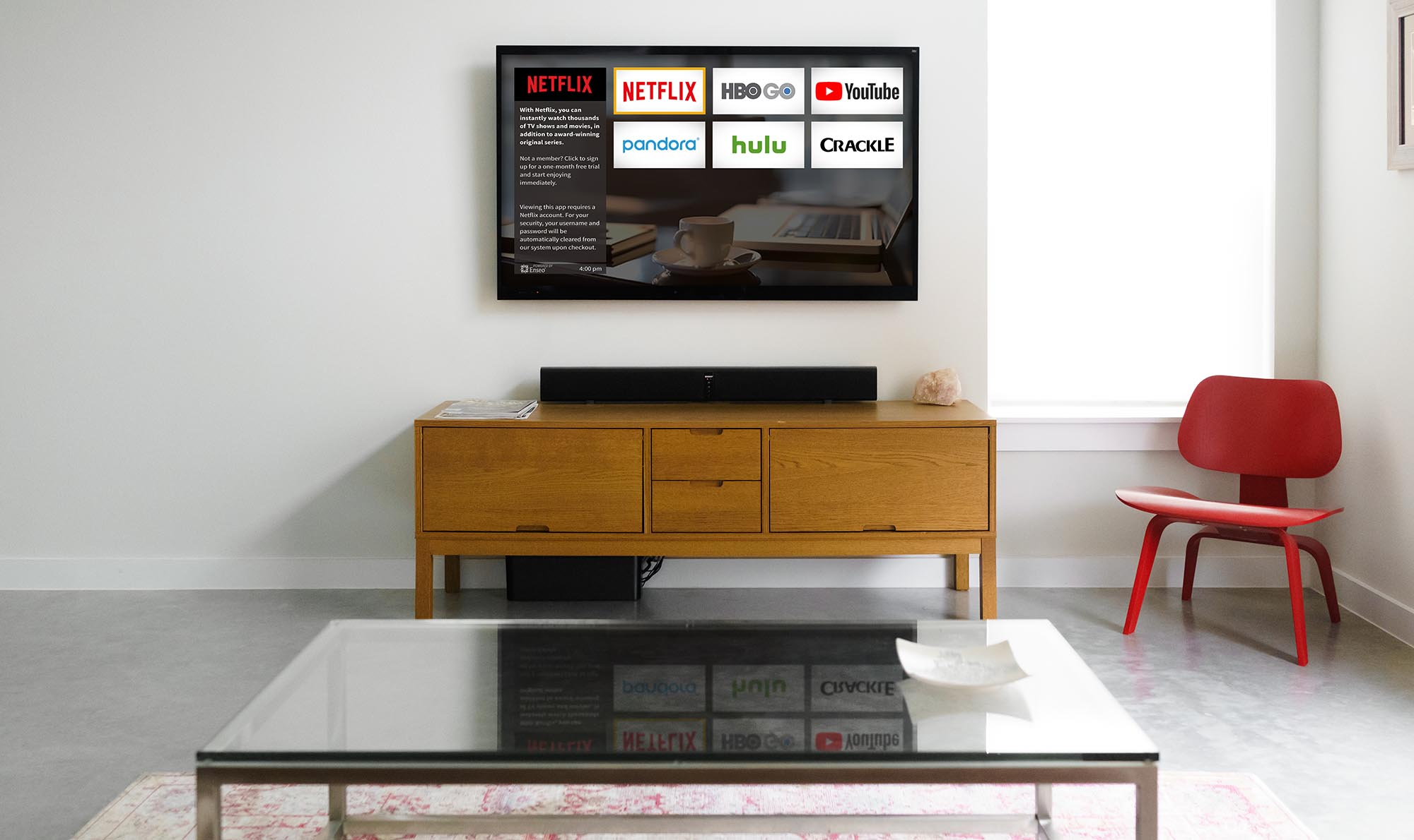brightly lit hotel room with tv displaying streaming apps