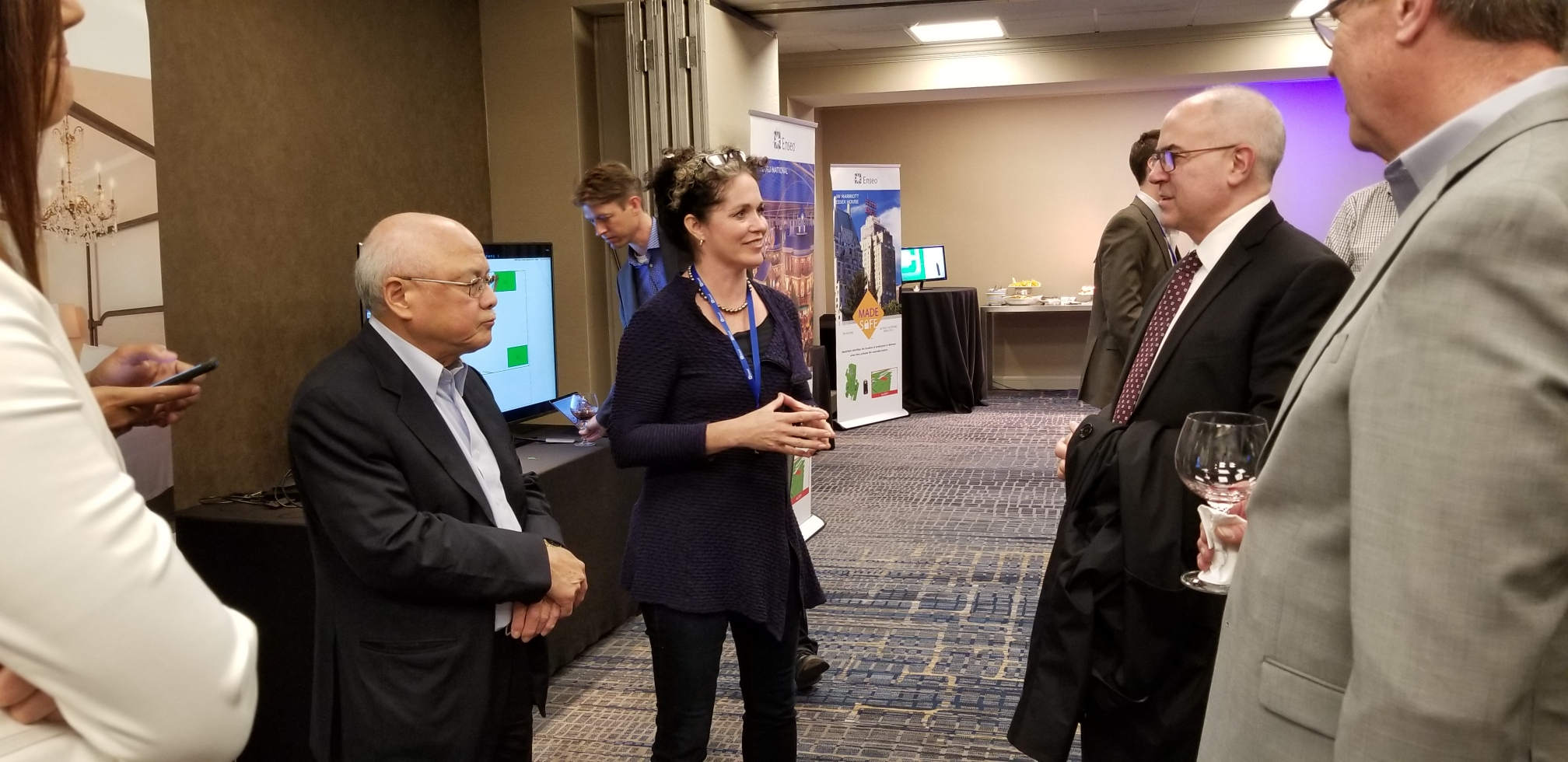 Enseo team members interact with hoteliers at a MadeSafe Demo Event